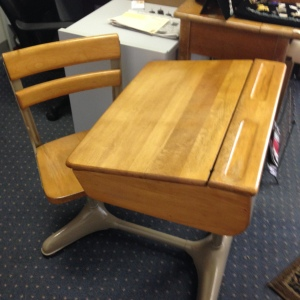 One of three types of old school desks we have. This one is practically immaculate!