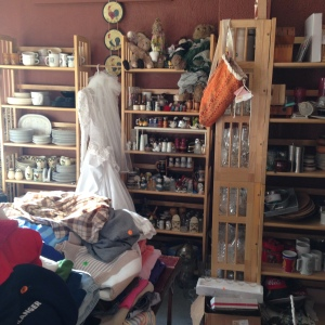 Papa's has dish sets, glassware, baskets, decorative items, lots of clothing, small electrical appliances, a big wood desk, several motorcycle/snowmobile helmets, shoes & clothing, and even a wedding dress!