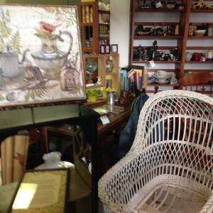 Wicker baby basket and shabby chic art.