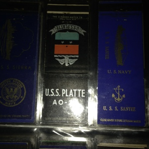 Some of the 174 WWII manufactured Navy ship matchbook covers represented in the album.