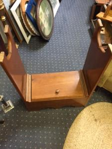 Top of storage area of interesting side table