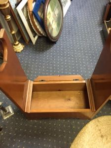 Inside storage area of interesting side table