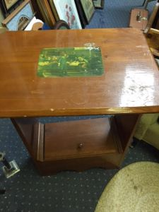 Top of interesting side table with sealed picture