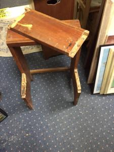 The very cool vintage stool needs work to keep bottom step attached