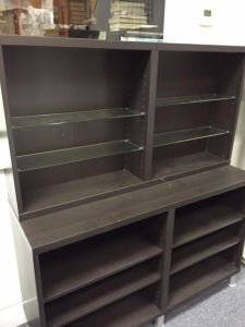 """Two Ikea Bookcases. The top one is about 47.5""""W x 25.25""""H x 8""""D; the bottom one is about 47.5""""W x 29.25""""H x 15.5""""D. Our price: $45.00 for the smaller one; $75.00 for the larger one (which sits on legs)."""