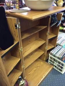 """CD Cabinet - 44""""H x 23.5""""W x 14""""D when closed; open, the cabinet can be up to twice as wide. Appears to be Sauder brand, which means the original price was about $169.00, Our price for this used cabinet in good shape was $50.00; it's been reduced to $35.00 because we need the room!"""
